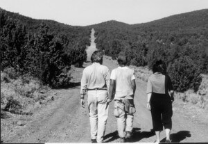 Family walking down a dirt road