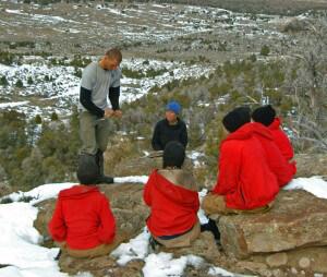 Field staff instructing students