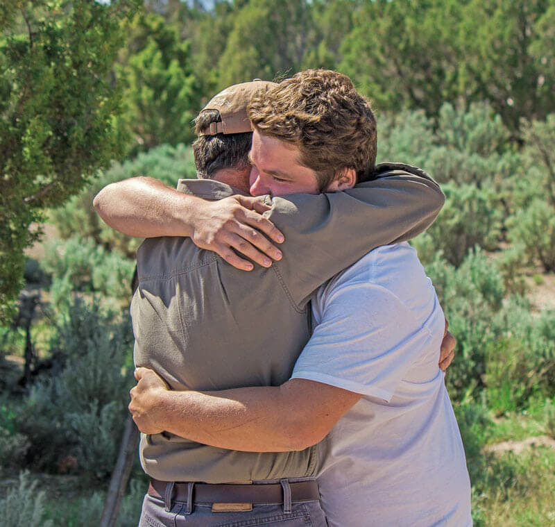 After Wilderness Family Therapy Dad and Kid Hug